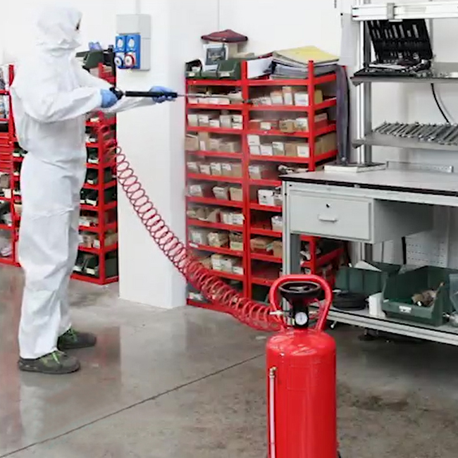 Manually disinfecting workshop area in a factory with spray lance kit
